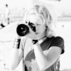 ninamazing: Black & white medium close up of Veronica Mars shooting a photo at the beach, from S1. (your telephoto is sexay)
