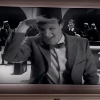 dc: The Doctor looking out from Laurel & Hardy film (Hello, Dr Who, fez)