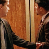 wordsatourbacks: standing in front of an elevator, mike reaches out for meldrick and touches his left arm—homicide: life on the street (sweet talk)