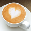 kass: a latte in a teacup with a heart shape drawn in the foam (latte)