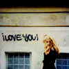 "balsamandash: stock: a woman looking at grafiti that says ""i love you!"" (s] it's just the weight of the world, > I love you!)"