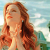 balsamandash: Kat (Eastwick) clasping her hands together and looking off and up (ew] the heartlines on your hand)
