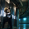 labellementeuse: a bare corridor with a barred prison cell to the left and two people kissing in front of it. (dw I ship it so hard)