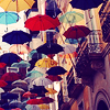 onyxlynx: Many umbrellas of various colors descending across a building façade.  What?! (It's Raining Umbrellas!)