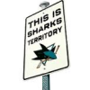 james: A traffic sign saying This is sharks territory. (hockey_sharks_territory)
