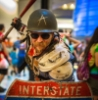 aaaaaaaagh_sky: Goateed man wearing spiked football armor, and an Army helmet, wielding a bat and wearing an Interstate sign as a shield (PA - Major Wasteland)