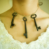 nextian: A woman in a Victorian dress with three old keys around her neck. (eyai)