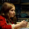 yati: Amelia Pond sitting at her kitchen table. (fish fingers and custard)