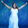 amadi: Queen Latifah in an ankle length white sleeveless dress, raises both hands over her head triumphantly, smile on her face (\o/)