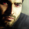 okami_no_mure: Close up of Derek looking slightly down and off-screen, eyes glowing red. (Derek)