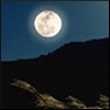 curiosity: A large full moon over a mountain slope. (Picto: Moon and Mountain)