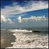 curiosity: An interesting play of ocean waves and clouds. (Picto: Blue Clouds)