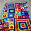 curiosity: A crocheted afghan made of bright colors and differently sized granny squares. You know you want it. So warm. So cuddly. (Picto: Crazy Color Afghan)