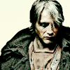 fanatic_os: hollow-faced & eyed man, threadbare clothes, in a big cloak, looking down (post-death: cloaked)