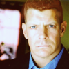 bigraudr: big redhead man with blue eyes, slightly scowly neutral expression, head on (suspicious; on the job; neutral unfriend)