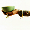 ephemera: an outstretched hand holding a bowl of tea (Tea for you?)