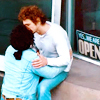 "mjules: Two men kissing in front of a store window with a sign that says ""Yes We're Open"" (Yes We're Open)"