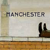 manchester: LS Lowry painted boots kicked up on a red brick wall in front of grey Manchester skies (pic#84552)