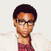 aaaaaaaagh_sky: Donald Glover wearing eyeglasses and a red plaid shirt. (Painless Parker)
