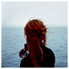 intinn_na_drui: rear shot of a dark redhead with half-bound hair starin out at an ocean (Brigh)