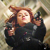 jenna_thorn: black widow on a wire descent rig, shooting at the viewer (widow)