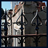 sofiaviolet: wrought-iron fence and crumbling tomb in St. Louis No. 1 in New Orleans (so goth i hang out in graveyards)