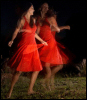 silly_cleo: A woman in a red dress dancing, artistically blurry/in motion. (dancing! - girl in red dress)