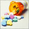 sofiaviolet: candy hearts from a prescription bottle (and now the red ones make me fly, and the blue ones help me fall)
