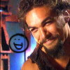 sgatazmy: Ronon smiling looking at a smiley face (excited, happy)