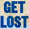 "flaneurs: The words ""get lost"" in capital letters superimposed over a map. (get lost)"