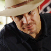 skieswideopen: Raylan Givens head shot, wearing The Hat (Justified: Raylan Givens head tilt, Justified: Raylan Givens in bed)