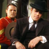 skieswideopen: Murdoch in a suit crouching down looking at something with his Mountie brother crouched behind him (Murdoch Mysteries: Linney & Murdoch)
