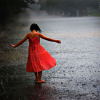rainsoaked: A girl in an orange-red dress, walking barefoot in the rain. (Default)