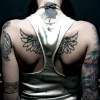 melospiza: (general - tattoo wings) (Default)