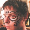 kirby1024: Me with tribal-esque facepaint and serious expression (Face Forward)