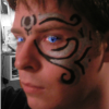 kirby1024: Me with tribal-esque facepaint and alien eyes (Tattoo Animal Eyes)