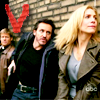 meridian_rose: Jack, Hobbes, and Erica against a wall with the red V logo in corner (v: fifth column)