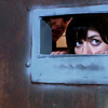 mortalcity: Gwen Cooper peeking into a jail cell through a tiny opening. (TW | is it safe to come out?)