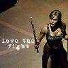 "yvi: Teyla with fighting stick, text: ""love the fight"" (Atlantis - Love the Fight)"