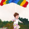 "azurelunatic: A pajama-clad small child uses a rainbow-striped cruciform parachute. From illustration of ""Go the Fuck to Sleep"". (insomnia)"