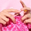 alexseanchai: White hands knitting something pink (Pink knitting)