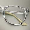 emceeaich: A close-up of a pair of cats-eye glasses (Default)