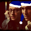 kass: Harold and John wearing blue Santa hats. (Santa Harold)