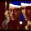 kass: Harold and John wearing blue Santa hats. (Santa Harold)