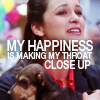 metatxt: amy santiago holds puppies while looking slightly pained. text reads: my happiness is making my throat close up (b99: happiness throat close up)