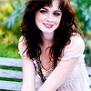 dreamwriteremmy: Alexis Bledel, a brunette smiling sitting on a bench (DreamWriter - Alexis Bledel on a bench)