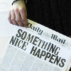 rising: something nice happens, as a front page newspaper headline. (the cadre: something nice)