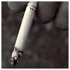 musyc: Stock photo of a lit cigarette (B/W: Cigarette)
