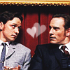 ysobel: Charles and Erik, sitting shoulder to shoulder and looking at each other, with a heart between them (xmfc - heart)