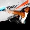 rydra_wong: Angelica Lind stretches for a hold during a bouldering competition (climbing -- reach)